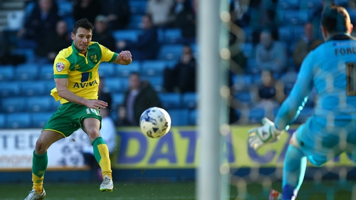 Wes Hoolahan watches his shot power towards the net