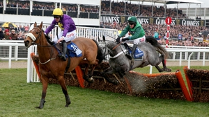Windsor Park and Davy Russell jump the last flight at Cheltenham in the Neptune Investment Management Novices' Hurdle