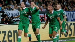 O'Shea wheels away to celebrate his leveller in Germany