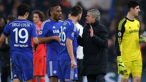 Jose Mourinho talks to his players ahead of extra time