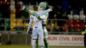 Shamrock Rovers goalkeeper Goalkeeper Craig Hyland with mascot Hooperman after the game against St Pat's on Friday