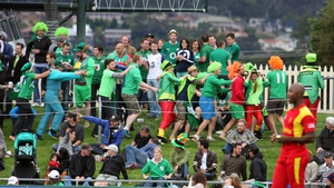 Ireland fans celebrate winning against Zimbabwe in the Cricket World Cup on Saturday