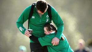 Irish fan Jennifer Malone from Clane, Co Kildare hugs Peter O'Mahony before training on Tuesday