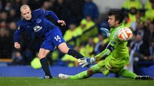 Steven Naismith scores past goalkeeper Oleksandr Shovkovskiy of Dynamo Kiev