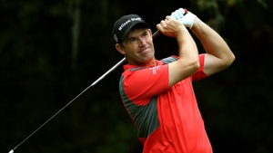 Padraig Harrington watches his shot go wayward from the 11th tee