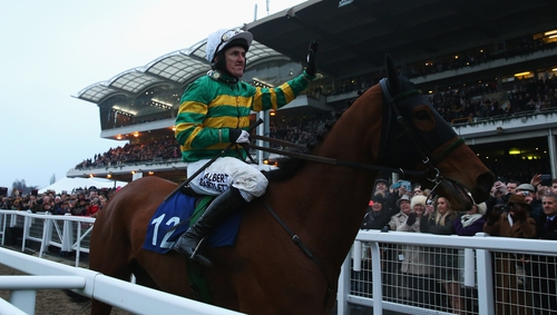 Tony McCoy on Ned Buntline waves to the crowd after his final race at the Cheltenham Festival