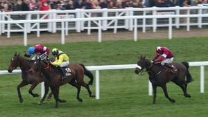 Bryan Cooper (R) riding No More Heroes in the Albert Bartlett Novices Hurdle