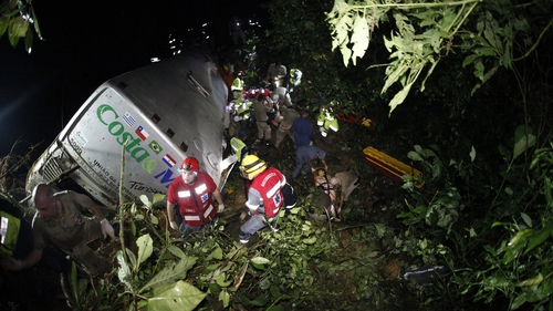 Members of emergency services work at the crash site in Santa Catarina