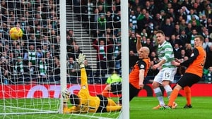 Kris Commons of Celtic scores the opening goal of the game