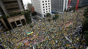 Dressed in the yellow and green of Brazil's flag, many protesters demanded the impeachment of Ms Rousseff