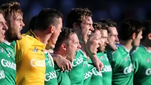 Ross Munnelly and the Ireland players sing the national anthem during the 2014 International Rules Test in Perth