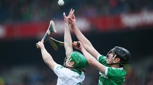 Joey Holden and Paddy O'Loughlin contest the sliotar