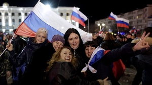 Women enjoy a concert marking the one-year anniversary of Crimea