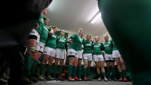 Ireland captain Niamh Briggs talks to her team before the game against England