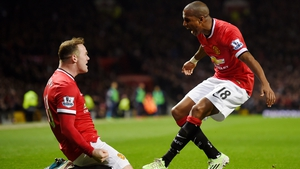Ashley Young (R) with Manchester United team-mate Wayne Rooney