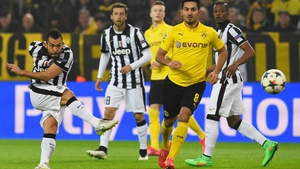 Carlos Tevez fires Juventus into a first-half lead at Dortmund