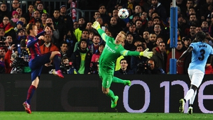 Ivan Rakitic of Barcelona lobs over Joe Hart against Manchester City at the Camp Nou