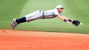 Ian Kinsler of the Detrout Tigers lunges acrobatically for a ground ball during the fifth inning of a spring training game against the Houston Astros at Osceola County Stadium in Florida
