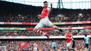 Olivier Giroud celebrates scoring  Arsenal's opener in the Gunners' 3-0 victory against West Ham at Emirates Stadium