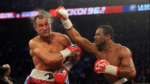 Sergey Kovalev recoils after Jean Pascal connects with a thundering right during their light heavyweight championship unification bout at the Bell Centre in Montreal - defending champion Kovalev would go on to win with an eighth-round TKO