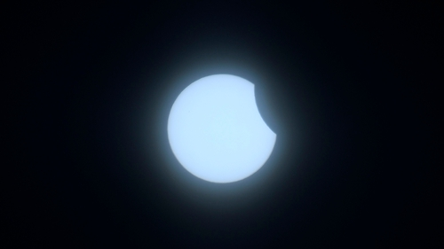 The moon begins to obstruct the sun as the eclipse gets under way