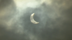The crescent sun - the moon moves across to block out much of the sun
