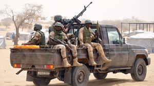 Nigerian soldiers patrol a refugee camp following recent Boko Haram attacks in the Diffa region of Niger