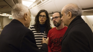 Spanish Home Minister (R) and Spanish Foreign Minister (L) chat with Spanish tourists Cristina Rubio (2-L) and Juan Carlos Sanchez (2-R), both caught inside the National Bardo Museum during the attack