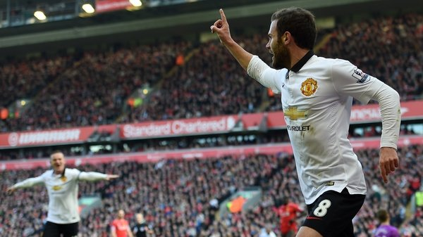 Manchester United's Spanish midfielder Juan Mata (R) celebrates after scoring his first goal