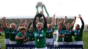 Niamh Briggs lifts the Women's Six Nations trophy aloft after they thrashed Scotland at Broadwood Stadium near Glasgow