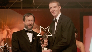 Receiving one of his 11 All Star awards from then GAA President Sean Kelly in 2004