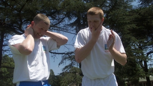 With Damien Fitzhenry, slapping on the sun screen during the All Stars trip to Buenos Aires in 2002