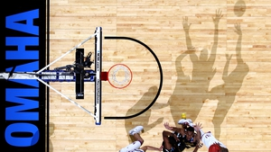 Shadows play ball during Kansas Jayhawks v Wichita State Shockers in the NCAA Tournament in Omaha, Nebraska