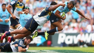 Kurtley Beale of the Waratahs is tackled during the Super Rugby match between the Waratahs and the Brumbies at Allianz Stadium in Sydney