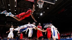 Kyle Davis of the Dayton Flyers goes to the basket against Chandler Hutchison of the Boise State Broncos during the NCAA Tournament at UD Arena in Dayton, Ohio