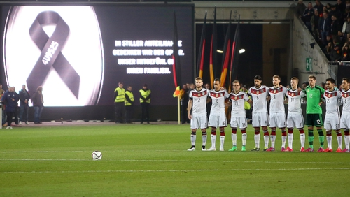 German national soccer team players observe a minute of silence for the victims of the Flight 4U 9525