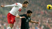 Ireland's Shane Long and Lukasz Szukala of Poland battle for the ball in 2013