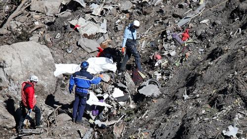Investigators at the crash site in the Alps