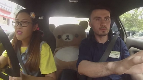 Leona Chin, a teddy bear and a driving instructor