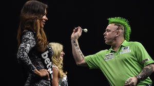Peter Wright playing up to the locals in his (week-late) Paddy's Day rig out with matching mohican