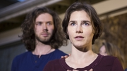 Amanda Knox speaks to the media during a brief press conference in front of her parents' home with her fiance Colin Sutherland