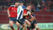 Munster out-half Ian Keatley (carrying ball) got the better of his opposite number Jack Carty (tackling left)