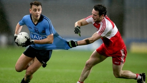 Cormac Costello of Dublin with Oisin Duffy of Derry