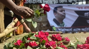 People leave flowers as a mark of respect for murdered blogger Avijit Roy in Dhaka on 6 March
