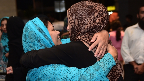 One of more than 500 Pakistani citizens evacuated from Yemen (R) greets a relative upon arrival in Islamabad