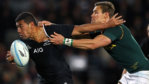 Charles Piutau fends against JJ Engelbrecht of South Africa during The Rugby Championship