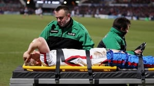 Stuart Olding goes off on a stretcher after the injury sustained against the Cardiff Blues
