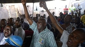 People react as results of the election show opposition challenger Muhammadu Buhari ahead