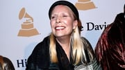 Joni Mitchell is described as being 'awake and in good spirits'