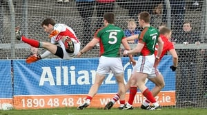 Mayo keeper David Clarke does his best Peter Schmeichel impression but cannot prevent Cork from scoring
